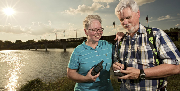 Geocachers Paulette Deutman and Martin Lollar hunt for GPS coordinates near White Rock Lake.