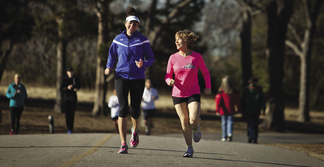 Joyce Kelley (right), who has the neurological disorder CMT, still trains with her running group: Kim Leeson