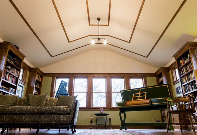 Neighbor Rene Schmidt added a second story to his home in Junius Heights Historic District — an expensive remodel that he believes was worth it because the historic district adds value to the 100-year-old homes. Photo by Danny Fulgencio