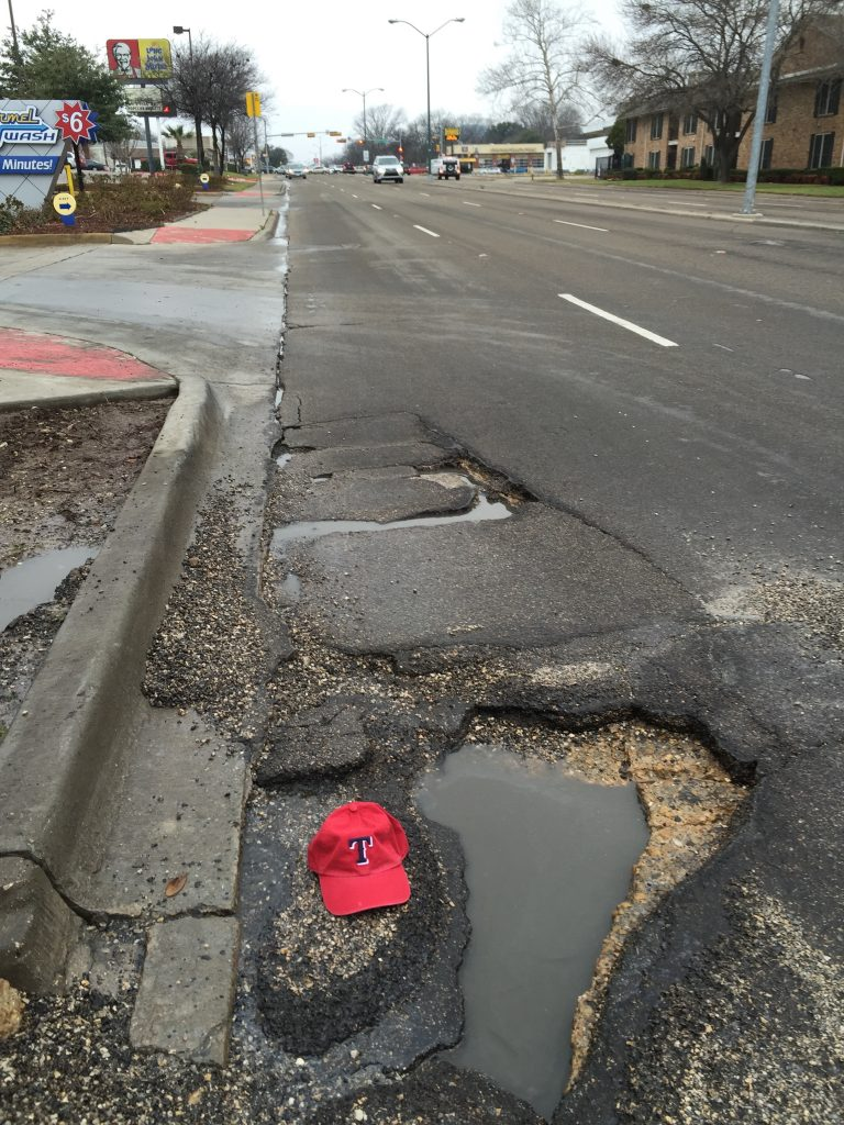 Watch out for the $197 pothole eastbound on Mockingbird east of Skillman.