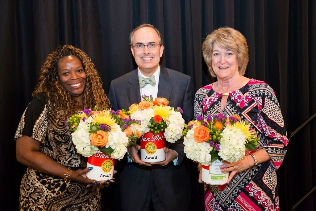 The 2015 recipients of the Can Do!  Awards were Wilkinson Center client Tonya Howard, Communities Foundation of Texas, and Wilkinson Center Shoe Drive Founder, Carlin Morris (right).
