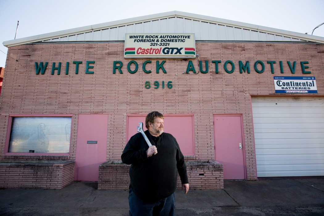 Mark Loving poses in front of White Rock Automotive January 27, 2016. Loving helps run the pink-colored shop after his father, Tom, started the business in 1964. The pink was recoated as a sign to Mark's grandmother's favorite color. (Photo by Rasy Ran)