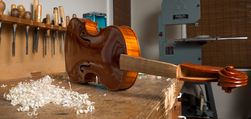 A violin in its varnished state, waiting to be finished out through a UV lightbox. (Photo by Rasy Ran)