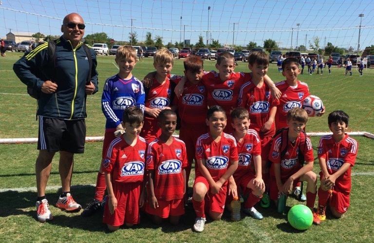 FC Dallas Central team includes kids from across East Dallas, pictured here with coach Daniel Rivas.