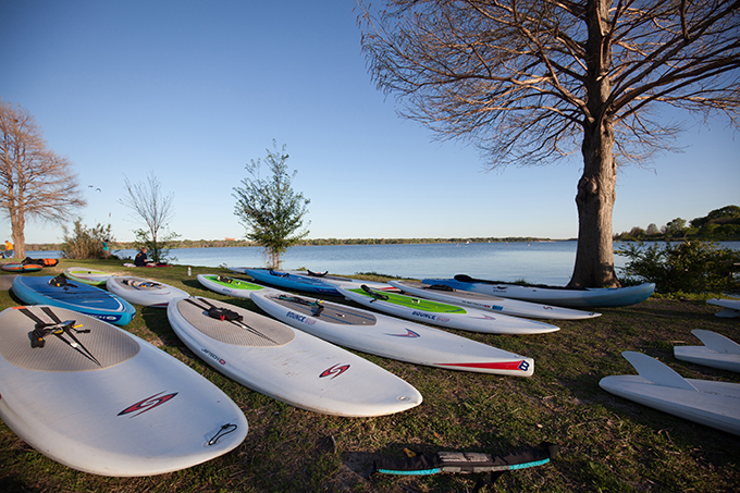 Paddle boards lay strewn on the shores of White Rock Lake. (Photo by Rasy Ran)