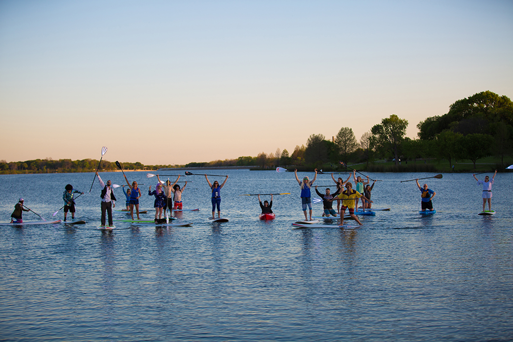 DFW Surf members meet every Thursday until October, inviting out members old and new to paddling and kayaking at White Rock Lake. (Photo by Rasy Ran)