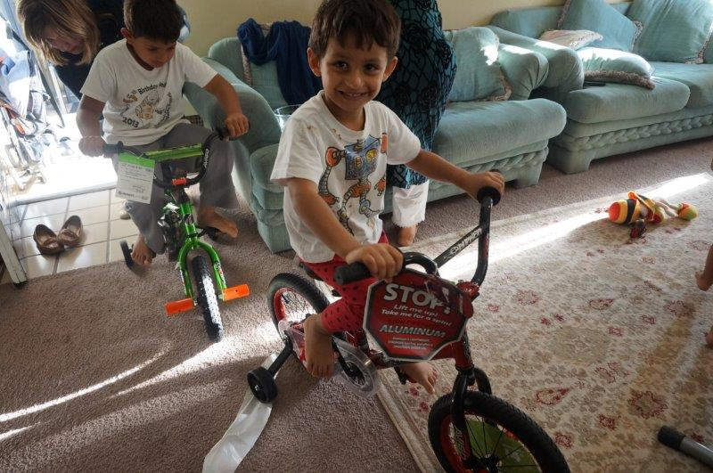 Young refugees at the Vineyard Apartment in East Dallas revel in their newly gifted toys. (Photo from DFW International Community Alliance)