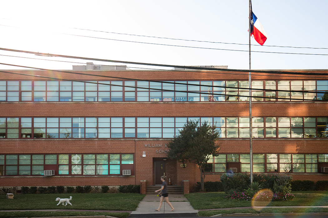 William B. Travis Academy/Vanguard For The Academically Talented and Gifted off McKinney Ave. in Uptown holds nearly one-fifth of its population from Stonewall and Lakewood communities. The academy shuttles enough kids to and from the pickup points at Lakewood and Stone Wall elementaries that two buses are needed. (Photo by Rasy Ran)