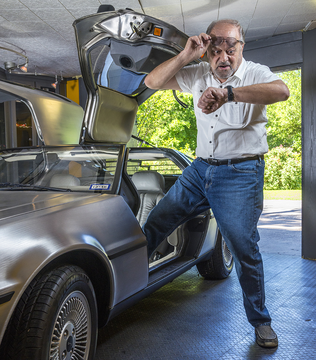 In his best Doc Brown pose, Jaime Sendra steps out of his 1980 DeLorean. (Photo by Danny Fulgencio)