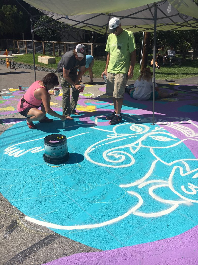 The whole neighborhood came together in Little Forest Hills to paint a street mural on Eustis on Sunday, June 11, 2017. (Photo by Emily Charrier/Advocate Media)