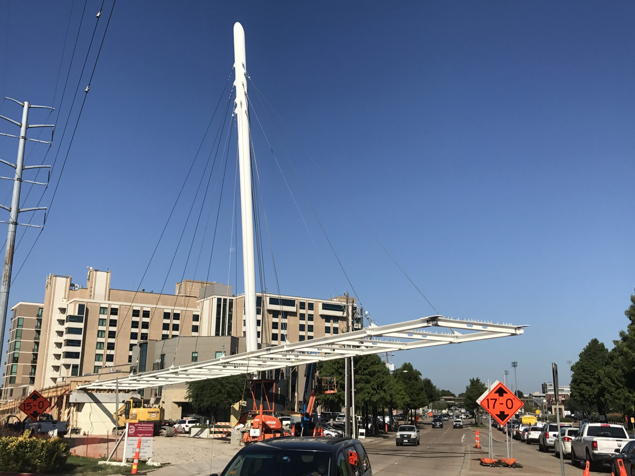 The final pieces of the pedestrian bridge at Mockingbird Station are following into place. (Photo by Advocate reader Jeff Snoyer)