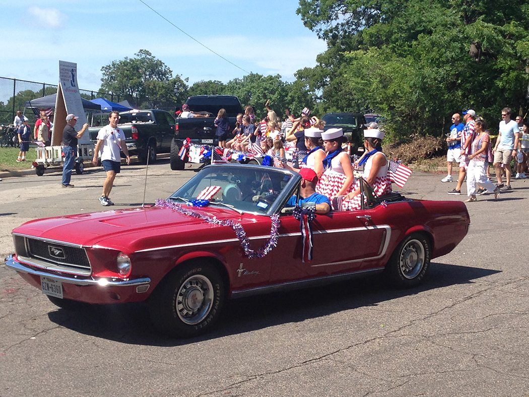 Convertible car with girls in sailor dresses at Lakewood's Fourth of July parade (Photo by Jynnette Neal).