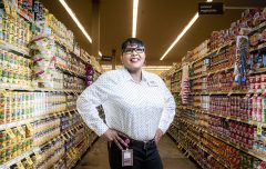 Tom Thumb manager Carrie Johnson poses in the canned food aisle.